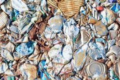 Packed trash at waste processing plant. Close up background of crushed trash block at modern recycling factory, copy space Stock Photos