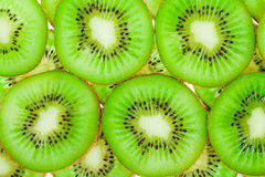 Close up background of green kiwi slices Stock Photos