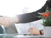 Close up.the background image of a handshake over the Desk. Business background stock photography