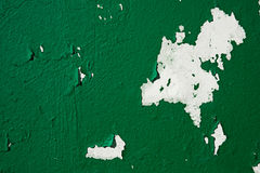 Close-up background peeled deep green paint on the wall Stock Image