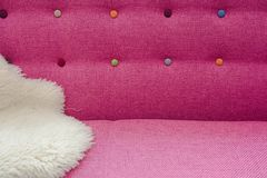 Close up background of pink color soft velvet bed headboard with rhinestone crystals different colors, front view royalty free stock image