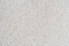 White Sand Background with Gritty Texture. Close up background shot of white sand. Gritty texture Stock Photography
