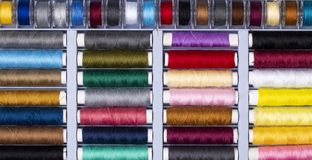 close up background spool of colorful sewing threads, top view stock photo