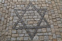 Star of David, Jewish symbol paved in stone. Close up background with Star of David, Magen David, Jewish religious and cultural heritage symbol on cobblestone Stock Photo