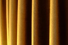 Close up of background texture a gold fabric pattern. Close up of background texture a gold fabric pattern Royalty Free Stock Image