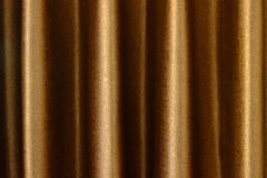 Close up of background texture a gold fabric pattern. Close up of background texture a gold fabric pattern Stock Images