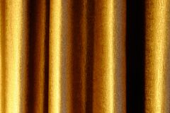 Close up of background texture a gold fabric pattern. Close up of background texture a gold fabric pattern Royalty Free Stock Photos