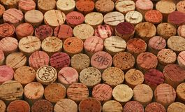 Close up background of used red wine corks. Close up background pattern of many assorted stacked used red wine corks, high angle view Stock Image