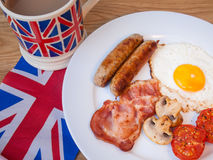 Close-up of Bacon and eggs with cup of tea and british flag Stock Photo