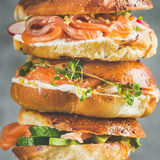 Close-up of Bagels with salmon, eggs, vegetables, capers, cream-cheese, herbs Stock Photo