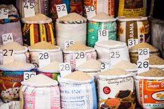 Close-up of bags of cereals and spices in a local country fair with italian names and prices.  royalty free stock image