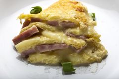 Close up of baked cake made from ham, eggs, cheese and sour crea Royalty Free Stock Photography