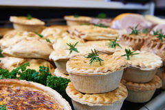 Close Up Of Baked Savoury Goods In Delicatessen. Baked Savoury Goods In Delicatessen royalty free stock image