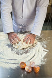 Close up of baker kneading dough Royalty Free Stock Image