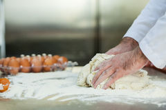 Close up of baker preparing dough Royalty Free Stock Photos