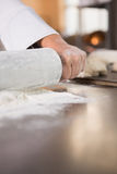 Close up of baker using a rolling pin Royalty Free Stock Images