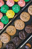 Close up of bakery display case with cookies and cupcakes royalty free stock photos