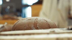 Close up of baking hot rye bread. Full HD stock footage