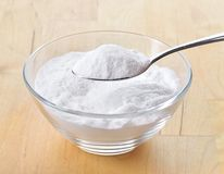 Close-up of baking soda on spoon. Royalty Free Stock Photos