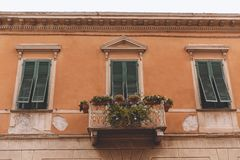 Close up of balcony with plants and flowers on old house with windows,. Pisa, Italy Royalty Free Stock Photography