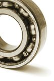 Close up of ball bearing. Close up of metal ball bearing standing on white background Stock Photos