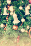 Close up ball and bell on Christmas Tree with retro filter effect (vintage style) Stock Photo