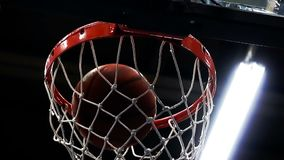 Close-up, the ball flies into the basket. Slow motion stock footage