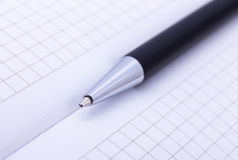 Close-up of ball point pen over paper Stock Images