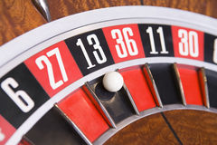 Close up of ball on roulette wheel. In number thirteen Royalty Free Stock Photo
