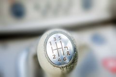 Close-up of Ball shift knob automatic transmission. Closeup car gearbox with blurred background. Switching in six steps and. Backing stock photos