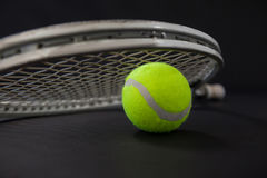 Close up of ball and silver tennis racket Royalty Free Stock Image