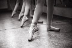 Close-up of ballerina feet on pointe shoes in the dance hall. V stock image