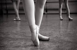 Close-up of ballerina feet on pointe shoes in the dance hall. Vintage photography. Close-up of a ballerina in the dance hall. stock images
