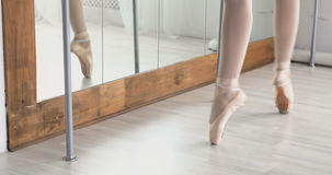 Close-up of ballerina feet in pointe shoes dancing ballet elements. Ballet dancer in the form of a black swan stock footage