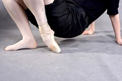 Close-up of a ballerina feet in pointe. Ballerina warming up feet before the rehearsal. Classical school of ballet stock images