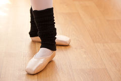 Close-up of ballerina's feet during a lesson. Close-up of ballerina's feet during a ballet lesson stock images