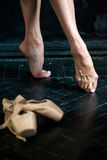 Close-up ballerina's legs and pointes on the black Royalty Free Stock Images