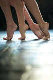 Close-up ballerina's legs on the wooden floor Royalty Free Stock Image