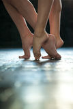 Close-up ballerina's legs on the wooden floor Stock Images