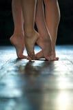 Close-up ballerina's legs on the wooden floor Stock Photography