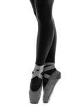 Close up of ballerina's shoes en pointe stock photo