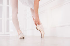 Close up of ballerina touching her ribbon Royalty Free Stock Photos