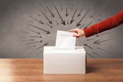 Close up of a ballot box and casting vote. On grungy background royalty free stock photo