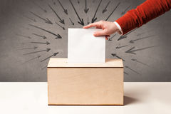 Close up of a ballot box and casting vote Royalty Free Stock Photography