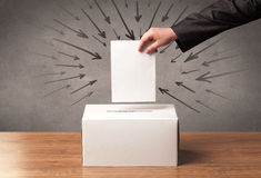 Close up of a ballot box and casting vote. On grungy background stock photography