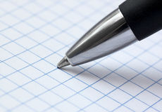 Close up of ballpoint pen. At paper Stock Photography