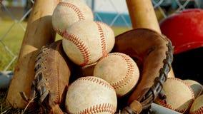 Close up on balls, a glove and bats of baseball