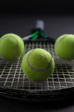 Close up of balls on tennis racket Stock Image