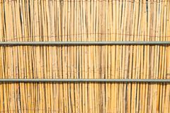 Close up of bamboo mat and iron pipe. Background Royalty Free Stock Photography