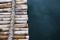 Close-up bamboo raft on the water. Close up bamboo raft on the water Royalty Free Stock Image